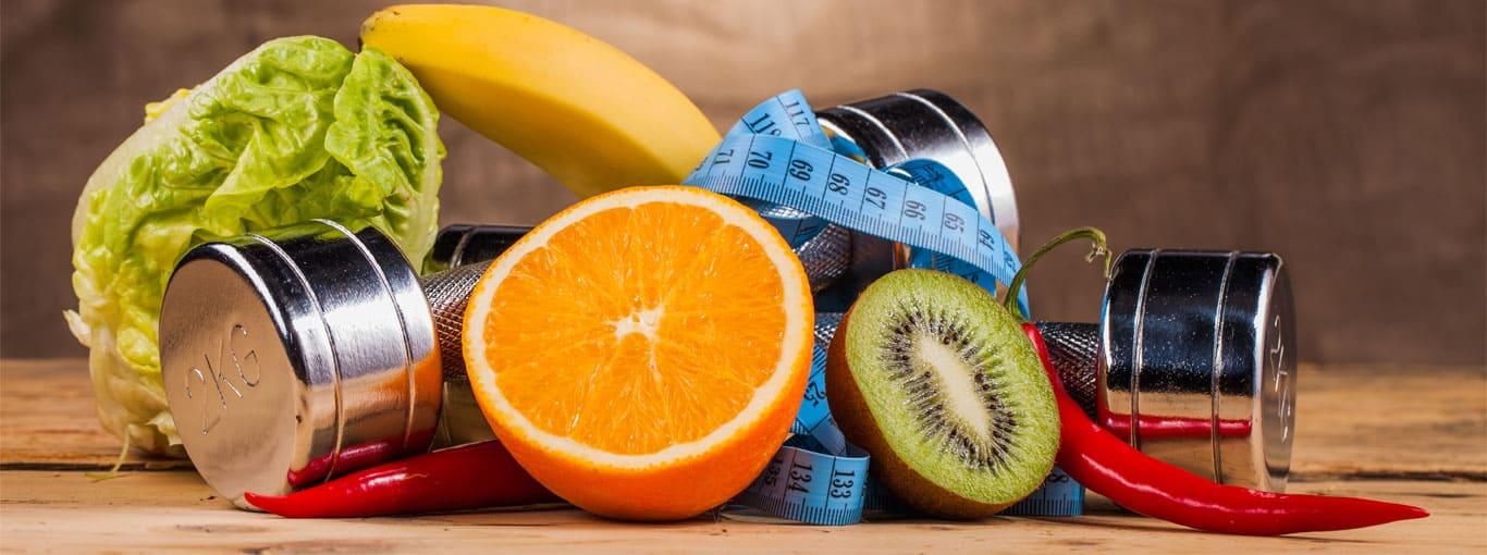 Ausbildung in der Sporternährung  - Obst und Hanteln